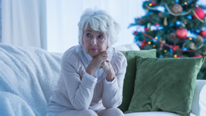 woman sitting alone at Christmas