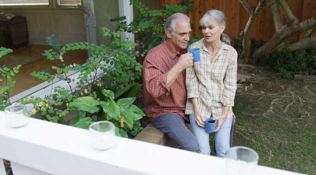 Couple in garden after downsizing