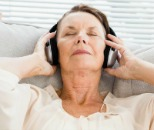 woman listening to relaxing music