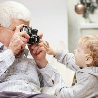 grandfather taking picture of grandson