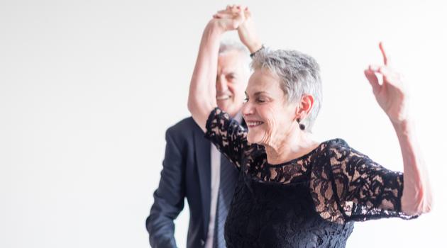 Senior Woman Dancing In Formal Dress