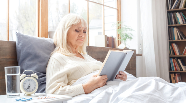 senior woman bed reading