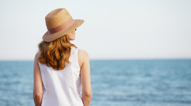 mature woman looking out to sea